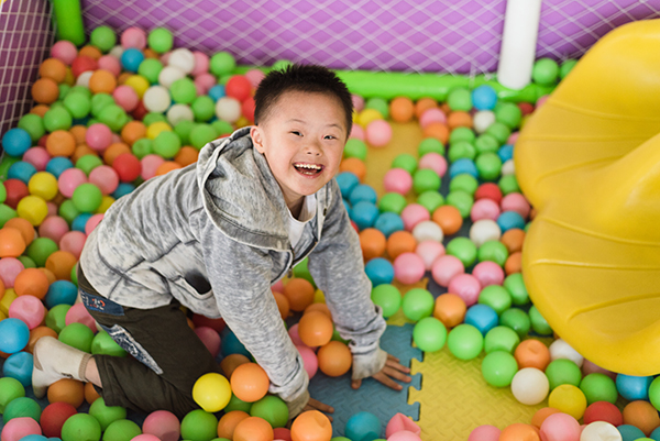 brody smiles in ball pit