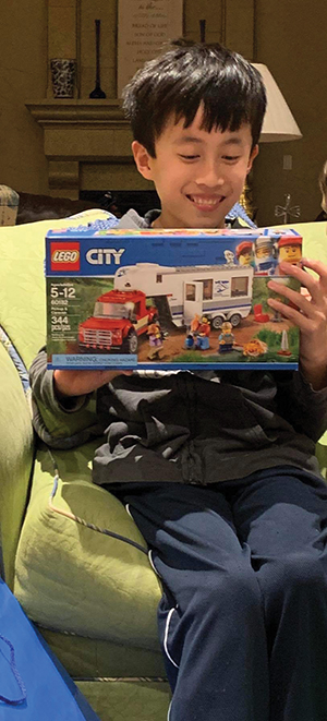 Timothy excitedly receives legos
