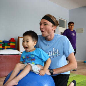 physical therapy intern makes therapy fun for young boy