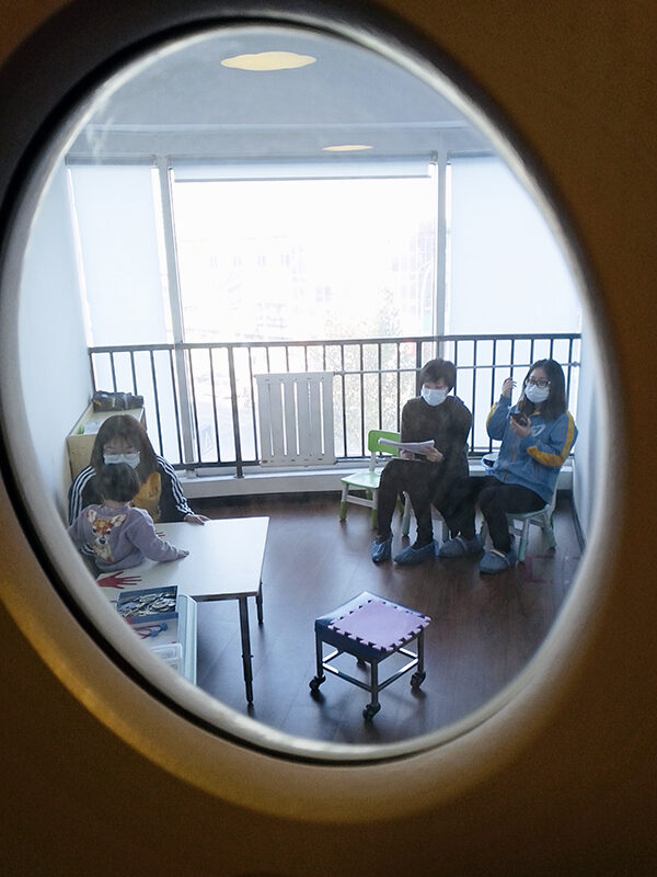 peek through window at therapy training session