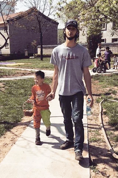 intern walking with small child