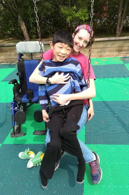 Katy in swing with Tyler, who has Muscular Dystrophy