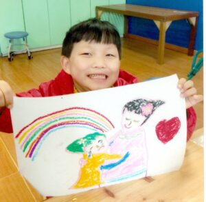 Maryanne holding picture she drew