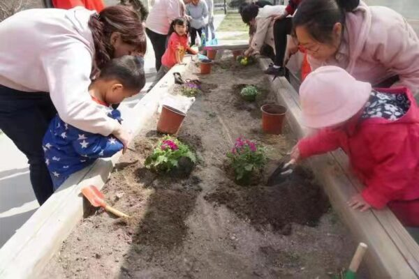 children and caregivers planting