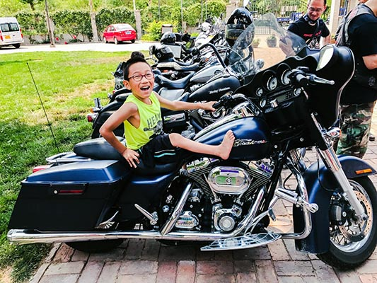 Hector perches on a Harley