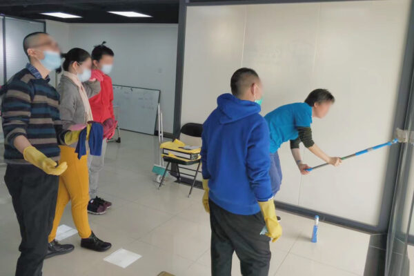 students learn how to wash windows