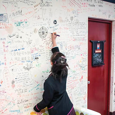 visitor writing on the wall of the Inn